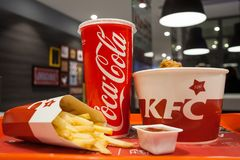 Minsk, Belarus - october 30, 2017: Lunch from chicken baskets, french fries, coca-cola and sauce a KFC restaurant. Lunch from chicken baskets, french fries Stock Photography