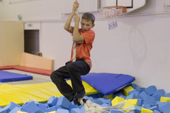 Minsk, Belarus - October 10, 2016: trampoline ride indoors. family entertainment. Royalty Free Stock Photo