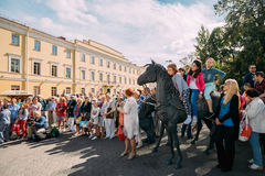 Minsk, Belarus. People Near Statue Of Carriage - The Governor Stock Photo