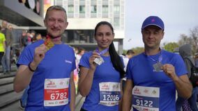 MINSK, BELARUS- SEPTEMBER 15, 2019: Athletes demonstrate their medals
