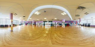 MINSK, BELARUS - SEPTEMBER, 2017: Full seamless panorama 360 angle degrees view inside interior of big fitness hall room with stock photography