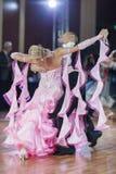 Minsk, Belarus-September 26, 2015: Kosyakov Egor and Belmach Ana. Stasiya Perform Adult Standard Program on III International IDSA World Dance Championship Royalty Free Stock Images