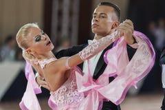 Minsk, Belarus-September 26, 2015: Kosyakov Egor and Belmach Ana. Stasiya Perform Adult Standard Program on III International IDSA World Dance Championship Stock Photos