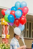 Minsk, Belarus - September 1, 2018 A man holding balloons for a royalty free stock image
