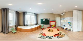 MINSK, BELARUS - SEPTEMBER 22, 2016: Panorama in children room in kindergarten with chess. Full spherical 360 by 180 degrees stock photo
