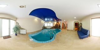 MINSK , BELARUS - SEPTEMBER 21, 2011: panorama of swimming pool inside interior of luxury vacation house . Full 360 degree stock photography