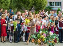Minsk, Belarus - September 1, 2018 The teacher gives first-grade royalty free stock images
