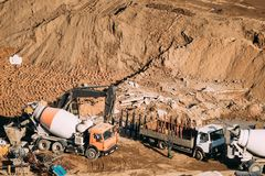 Minsk, Belarus. Special Concrete Transport Truck In-Transit Mixer Unit And Truck On City Building Site. Construction Of. Houses stock image