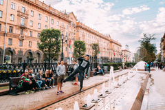 Minsk, Belarus. Teenagers Are Posing For A Photo Near The Fountain Stock Photography