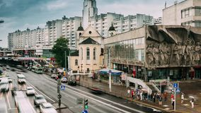 Minsk, Belarus. Traffic Near Cathedral Of Saints Peter And Paul And Bas-relief Of The Soviet Era On Old Facade Building. On Nemiga Street In Minsk, Belarus stock footage