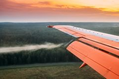 Minsk, Belarus. Twist Of Air On Wings Of Plane During Landing, Reduction Stock Photo