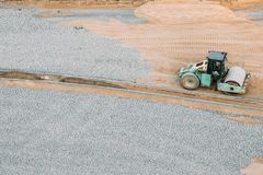 Minsk, Belarus. Vibrating Roller At WorkvOn City Building Site. Minsk, Belarus. Vibrating Roller At Work On City Building Site. Construction Of Houses Stock Photo