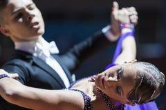 Minsk, Bielorrusia 15 de febrero de 2015: Pares de la danza de Shmidt Danila Fotografía de archivo libre de regalías