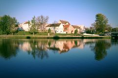 Minsk city landscape. With old style houses and reflection in the water Royalty Free Stock Photos