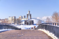 Minsk. Humpback Bridge to the island of Courage and Sorrow. MINSK, REPUBLIC OF BELARUS - January 18.2017: The bridge to the island of Courage and Sorrow monument Royalty Free Stock Photography