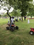 MINSK, MINSK, BELARUS, JULY 3, 2017; City holiday, Independence Day. Entertainment in the city park. Children ride on quad bikes royalty free stock photos