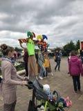 MINSK, MINSK, BELARUS, JULY 3, 2017; City holiday, Independence Day. Jesters on stilts entertain the people stock image