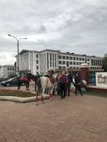 MINSK, MINSK, BELARUS, JULY 3, 2017; City holiday, Independence Day. Riding horses and ponies near the entrance to the park royalty free stock images