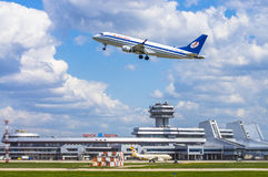 Minsk, Minsk National Airport, Belarus - May 06, 2016: Embraer E. RJ-175LR  EW-341PO Belavia Airlines  taking off on the background of the airport Stock Photography