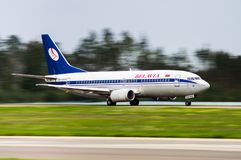 Minsk, Minsk National Airport, Belarus - September 06, 2016: Boe. Ing 737-300 EW-366PA Belavia Airlines landing at the airport Minsk; Speed blur Stock Photos