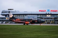Minsk, Minsk National Airport, Belarus - September 06, 2017: Boe. Ing 737-800 EW-254PA Belavia Airways in `World of Tanks` livery on the background of the Royalty Free Stock Images