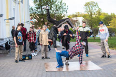 Minsk street dacers performing break dance. Minsk Belarus street dacers performing break dance on a piece of linoleum Royalty Free Stock Images