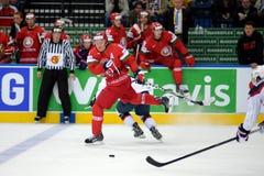 MINSK, WIT-RUSLAND - MEI 7: Mikhail Grabovski-de vleten met puck tijdens 2014 IIHF het Kampioenschap van het Wereldijshockey pass Royalty-vrije Stock Afbeeldingen