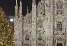 Minster illuminated windows and Xmas tree, Milan Stock Photography