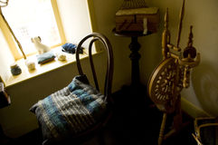 Minstrel Spinning Nook. I could easily move into this scene. Minstrel style single treadle spinning wheel. Sewing box in the background Stock Photography
