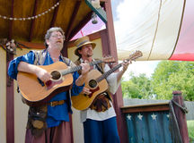Minstrels. Two guitar playing musicians serenade the audience at a performance during the Bristol Renaissance Faire Stock Images