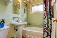 Mint bathroom with tile wall trim Stock Photo