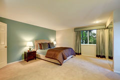 Mint and brown bedroom with beige carpet floor. Royalty Free Stock Photo