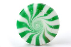 Mint candy. Single piece of green and white mint candy Royalty Free Stock Photography