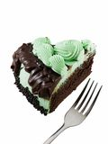 Mint Chocolate. Slice of mint chocolate cake with a fork isolated on white Stock Images