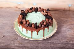 Mint and Chocolate cake. On the dark wooden table, selective focus Stock Photo