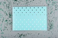Mint color notepad on a gray background with green sparkles royalty free stock images