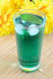 Mint drink. Cold glass of mint drink on bamboo mat royalty free stock photo