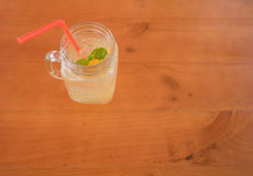 Mint in a glass of orange juice, selective focus , top view Royalty Free Stock Image