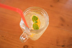 Mint in a glass of orange juice, selective focus , top view Royalty Free Stock Images