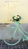 Mint green bicycle with white flowers. On a neutral background royalty free stock photos