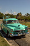 Mint Green Cuban Classic Taxi. Mint green classic Cuban taxi parked on the street Royalty Free Stock Photo