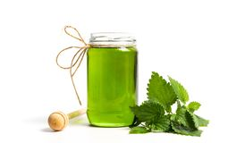 Mint green honey in a jar isolated. On white stock images