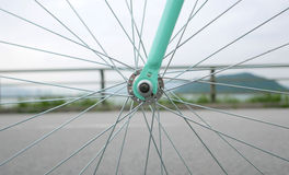 Mint green retro bicycle and rim closeup Royalty Free Stock Image