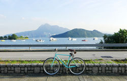 Mint green retro parked bicycle near lake and road Royalty Free Stock Image