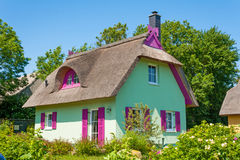 Mint green thatched-roof vacation house. Mint green thatched-roof vacation home with garden Stock Photo