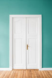 Mint green walls and wooden door in apartment. / home interior Stock Photo