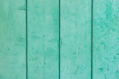 Mint green wood planks background texture. Light mint green colored old wood boards background texture, close-up stock image