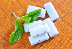 Mint gum. With fresh mint on the wooden table royalty free stock photos