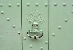 Mint handle door rusty iron ring. In wood doorway Stock Photos