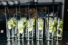 Mint ice and lime in the glasses. With the tubes. Royalty Free Stock Photos